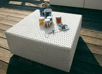 Contemporary coffee table / glass / resin wicker / square