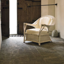 Contemporary armchair / rattan / fabric / wicker
