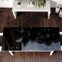 Dining table / contemporary / glass / resin wicker