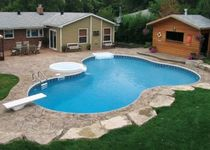 In-ground swimming pool / steel / wall / outdoor