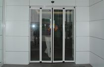 Folding entry door / automatic / glazed