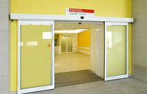 Sliding door / glass / automatic / for public buildings