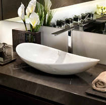Countertop washbasin / oval / marble / contemporary