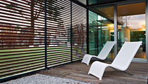 Contemporary lounge chair / Batyline® / aluminum / stainless steel