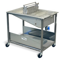 Donut glazing prep table / stainless steel / with sink / on casters