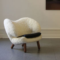 Contemporary armchair / upholstered / canvas / leather