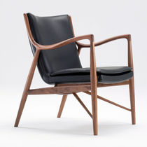 Contemporary armchair / upholstered / fabric / leather