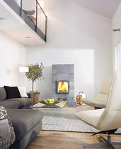 Wood heating stove / contemporary / stone / free-standing