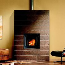 Contemporary fireplace surround / sandstone / stainless steel