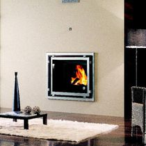 Contemporary fireplace surround / wooden / stainless steel