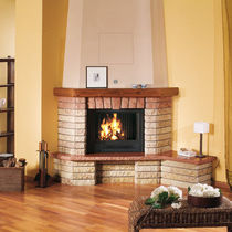 Traditional fireplace mantel / marble / wooden / corner