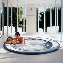 Built-in hot tub / round / 8-seater / outdoor