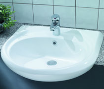 Semi-recessed washbasin / oval / ceramic / contemporary
