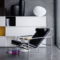 Contemporary armchair / leather / steel / with headrest