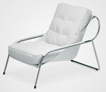 Contemporary armchair / leather / stainless steel / with footrest