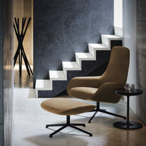 Contemporary armchair / fabric / leather / steel