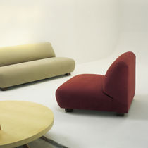 Contemporary fireside chair / fabric / with footrest / without armrests