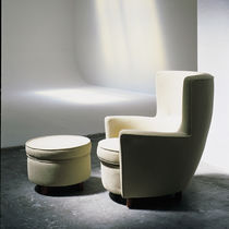 Contemporary armchair / fabric / with footrest / wing