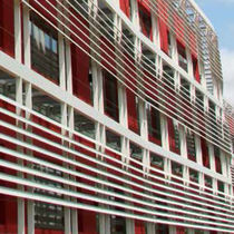 Particle board solar shading / for facades / motorized rotating / vertical
