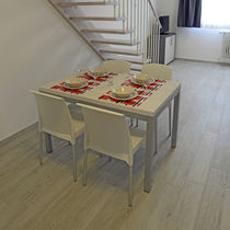 Contemporary table / metal / rectangular / for hotels