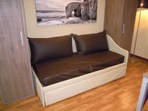 Contemporary daybed / synthetic leather / indoor / with wheels