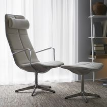 Contemporary armchair / leather / high back / with headrest