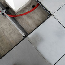 Raised access floor / porcelain stoneware / stainless steel / high-resistance / radiant