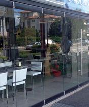 Folding partition / glazed / professional / frameless