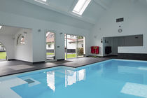 In-ground swimming pool / concrete / indoor / whirlpool