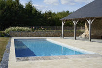 In-ground swimming pool / concrete / lap / outdoor