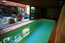 In-ground swimming pool / concrete / indoor
