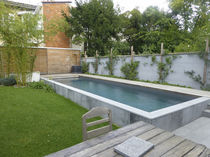 Semi-inground swimming pool / concrete / outdoor