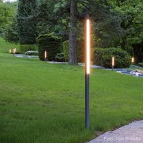 Contemporary light column / polycarbonate / stainless steel / fluorescent