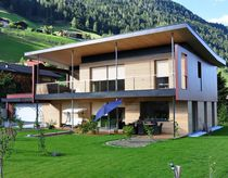 Prefab house / individual / contemporary / wooden frame
