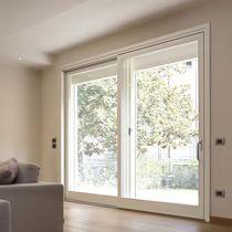 Tilt-and-slide patio door / wooden / quadruple-glazed / thermal break