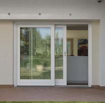 Tilt-and-slide patio door / wooden / aluminum / quadruple-glazed