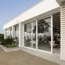 Tilt-and-slide patio door / aluminum / quadruple-glazed / thermal break