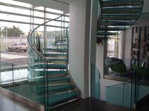 Helical staircase / metal frame / glass steps / lateral stringer