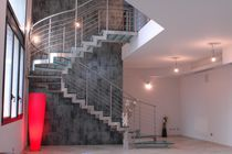 Circular staircase / metal frame / glass steps / lateral stringer