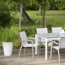 Contemporary garden chair / with armrests / stackable / ergonomic