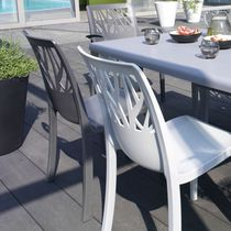 Contemporary garden chair / with armrests / stackable / with removable cushion