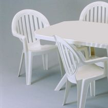 Contemporary chair / with armrests / stackable / PVC