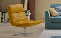Contemporary fireside chair / fabric / leather / swivel
