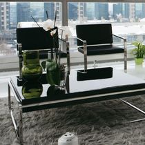 Contemporary armchair / leather / stainless steel / cantilever