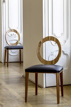 Contemporary dining chair / upholstered / with armrests / medallion