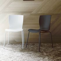 Contemporary chair / stackable / upholstered / leather