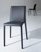 Contemporary chair / upholstered / leather / polymer