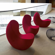 Contemporary fireside chair / fabric / beech / for public buildings