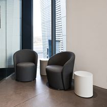 Contemporary armchair / swivel / fabric / leather