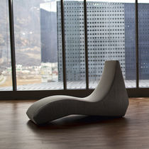 Contemporary lounge chair / fabric / leather / indoor